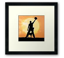 Male silhouette on background amazing sunset Framed Print