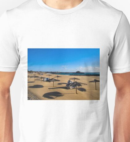 EMPTY BEACH AND STACKED SUNBEDS. Unisex T-Shirt