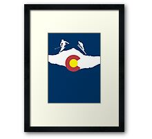 Colorado flag and skiing on mountain slopes Framed Print