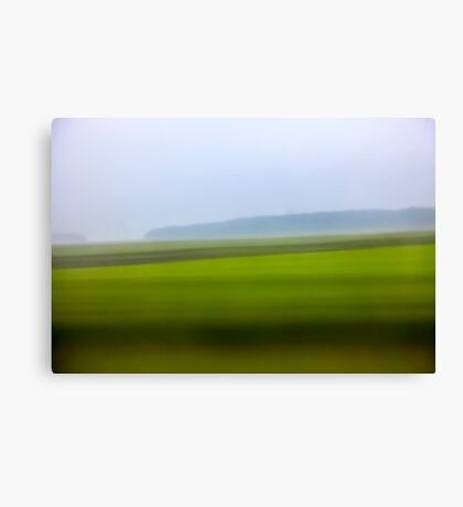 Motion blurred green landscape abstract Canvas Print