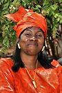 Liberian Woman in Dazzling Red by Carole-Anne
