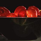 Tomatoes in a bowl by Judi Taylor