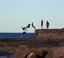 Youths dive off a rock platform on windang island by Vanessa Pike-Russell