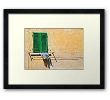 One-legged man's washing day Framed Print