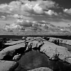Clouds over rockpool by Ben Kelly