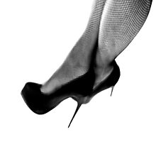 IT'S ALL ABOUT THE HEELS by June Ferrol
