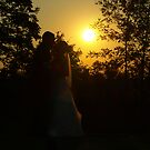 Sunset Newlyweds by Taryn Raburn