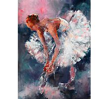 Ballet Dancer in White Dress Tying Shoe Ribbons Photographic Print