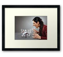 Furious businesswoman shouting at a subordinate Framed Print