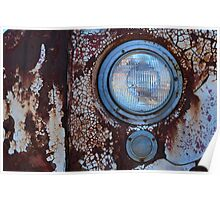 Front headlight of an abandoned farm truck. Poster
