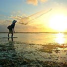 Balinese Fisherman Casting Net at Sanura Dawn by David Lang