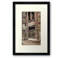 pastry shop window laid down sand bags Framed Print