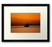 Diving in the sunset Framed Print