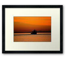 Diving in the sunset Framed Print