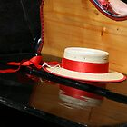 Straw hat on a gondola by Christian  Zammit