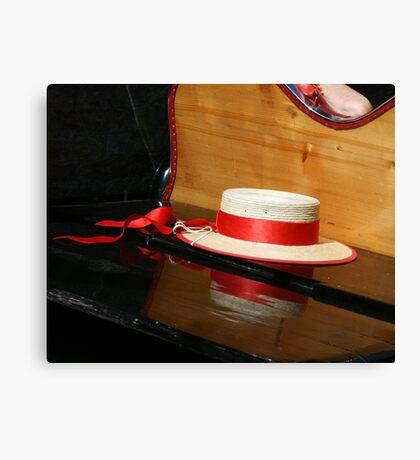 Straw hat on a gondola Canvas Print