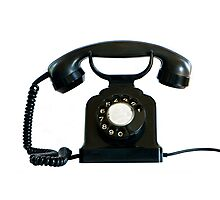 Old black phone isolated on white.   Photographic Print