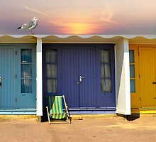 colourful and bright row of beach huts  bournemouth dorset uk  by chrissiexxx68