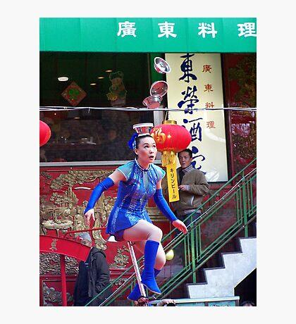 Gymnast balances bowls, onlookers amazed Photographic Print