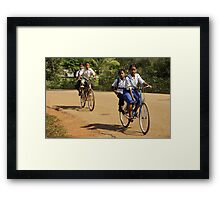 Childs on Bicycles - Cambodia Framed Print
