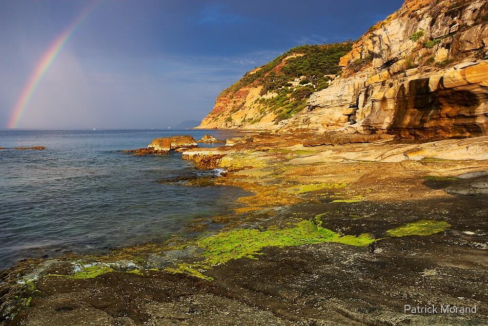 Rainbow over the sea by Patrick Morand