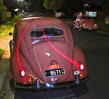 Volkswagen in Coral Red at night. by Ferenghi