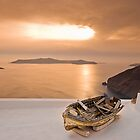 Lonely sunbathed boat by Yannis Larios