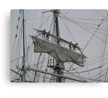 Tightening the main upper topsail Canvas Print