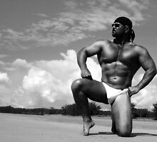 bodybuilder on the sand by physiqueart