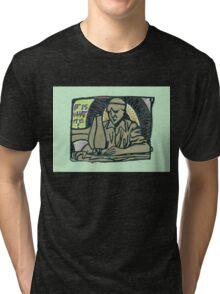 sculpture of the man at a sewing machine Tri-blend T-Shirt
