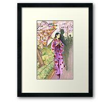 lady with a parasol Framed Print