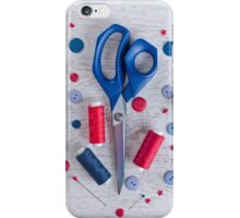 Sewing kit on a wooden table iPhone Case/Skin