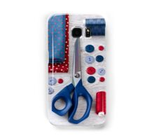 scissors, threads, fabric and buttons on wooden table Samsung Galaxy Case/Skin