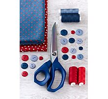 scissors, threads, fabric and buttons on wooden table Photographic Print