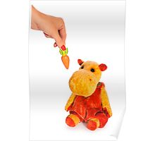 Isolated yellow hippo toy and hand with carrot Poster
