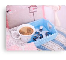 Cup of coffee on blue wooden tray with chocolate Canvas Print