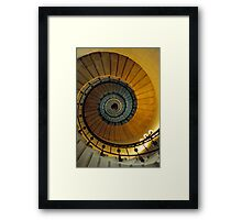 Spiral staircase in lighthouse, looking up, France. Framed Print