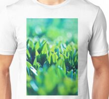 Natural green background with selective focus under the sun Unisex T-Shirt