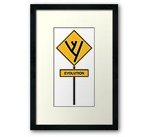 Evolution road sign Framed Print