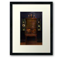 A cabinet Framed Print
