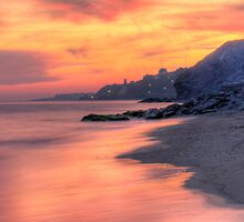 Sunset over the beach at Nerja by Charles Howarth