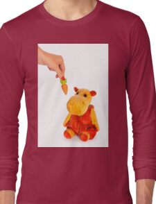 Isolated yellow hippo toy and hand with carrot Long Sleeve T-Shirt