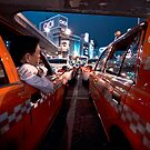 Two taxi drivers having a chat; Ueno Station, Tokyo, Japan by Alfie Goodrich