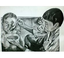 boy feeding his younger brother Photographic Print