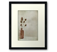 Stone jar of teasles Framed Print