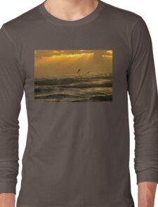Pelicans flying over ocean waves during sunrise Long Sleeve T-Shirt