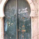 Graffiti on an Ancient Door in Tunisia by DeborahDinah