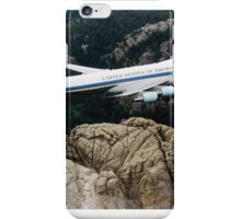 Air Force One, the typical air transport of the President of the United States of America, flying over Mount Rushmore. iPhone Case/Skin