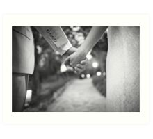 Groom holding hands with bride black and white wedding photograph Art Print