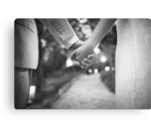 Groom holding hands with bride black and white wedding photograph Canvas Print